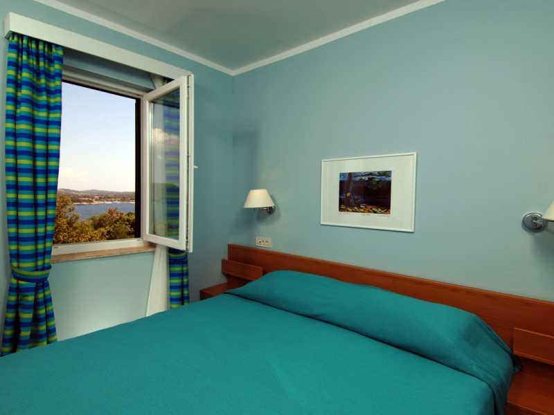 Naturistenresort Koversada appartementen slaapkamer